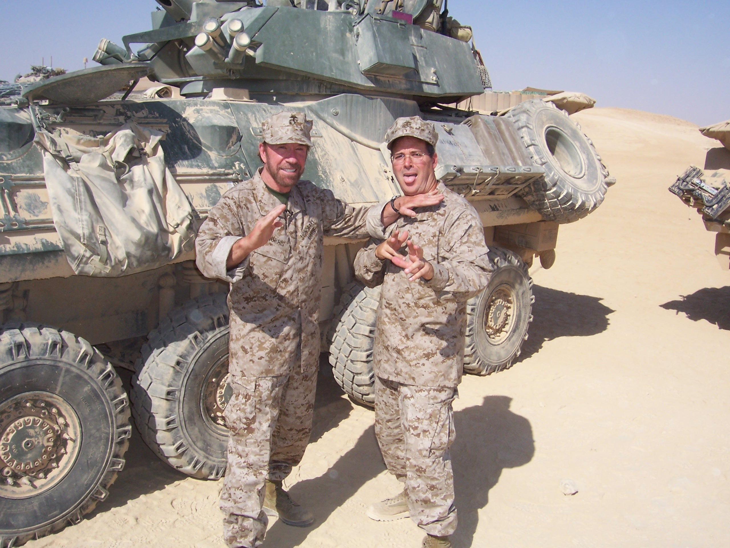 Chuck gives Chaplain Todd a karate chop in Iraq!